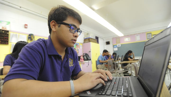 Ryan Manglona and fellow students use laptop computers