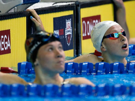 Fossil Ridge's Zoe Bartel (right) after competing in the women's 100 breaststroke preliminary heats in the U.S. Olympic swimming team trials at CenturyLink Center on Monday.