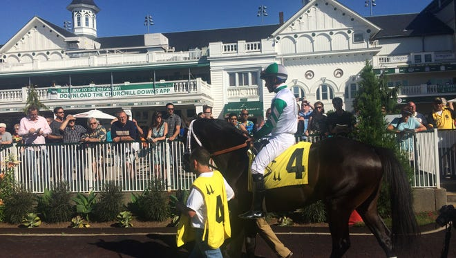 Warrior's Club, with Gary Stevens aboard, heads out of the paddock and toward the track on Thursday at Churchill Downs.