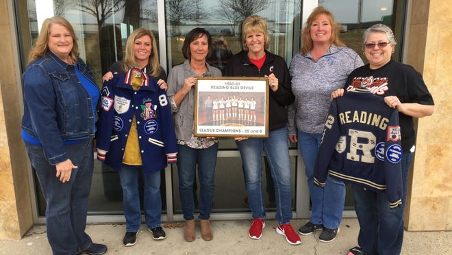 From left, Karen Niehaus Hall, Julie George Onnen, Jenny Gilligan, Shelly Klare Cummins, Andrea Irwin Baker and Connie Burdine Adams with the 1980-1981 team photo.