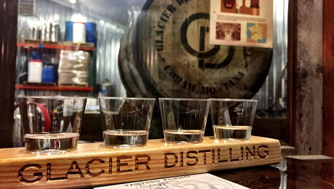 This flight at Glacier Distilling in Coram included grappa, pear eau-de-vie, kirsch and little cottonwood herbal liqueur. Windows from the tasting room look onto the production floor.