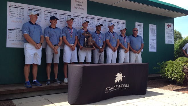 Novi Detroit Catholic Central pose for a photo after winning their third consecutive Division I golf state title in the state tournament at Forest Akers West in East Lansing on Saturday, June 10, 2017.