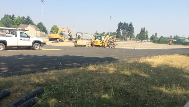 Construction continues on McKay's new artificial turf field Wednesday.