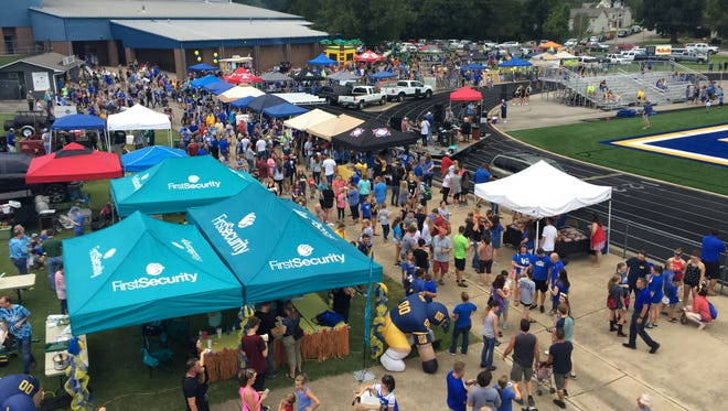 Throngs of fans and exhibitors enjoy First Security Bank's BomberFest Friday night at Bomber Stadium.