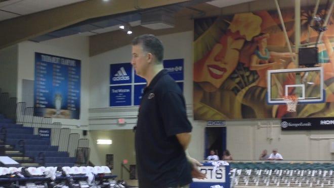 Purdue coach Matt Painter watches practice at the Lahaina Civic Center.