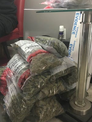 More than 15 pounds of marijuana was confiscated during an early morning raid Wednesday at a house in Port St. Lucie