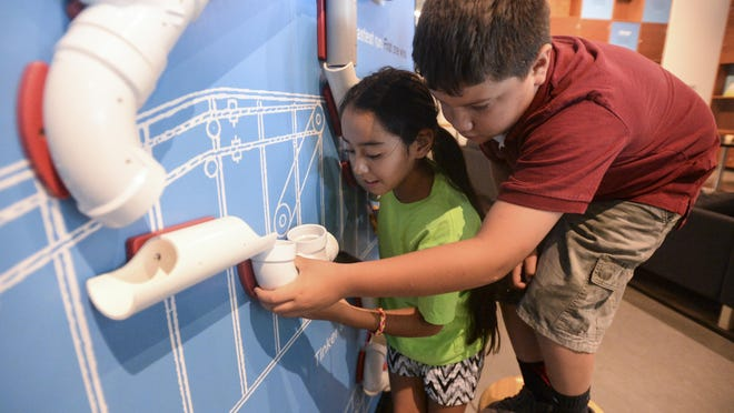 Jocelyn Mendoza and Jair Solano, right, check out an exhibit Tuesday at the Museum of Discovery. They attend La Familia/The Family Center, which is one of 378 active nonprofits in Larimer County, according to a Coloradoan analysis of the Secretary of State's nonprofit database.