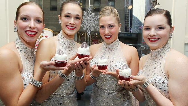 -  New York NY - 12/18/13 -  The Rockettes make the holidays even sweeter with a special Magnolia Bakery Rockette Red Velvet Cupcake, available exclusively at the Rockefeller Center location, in celebration of the 2013 Radio City Christmas Spectacular, running now through December 30.  Customers who purchase the Rockette Red Velvet Cupcake will receive a discount show voucher.   Amelia Rockette Danielle Betscher, with fellow Rockettes, L-R: Megan Miller, Jessica Davison, and Elizabeth Bork, at Rockefeller Center, N.Y.