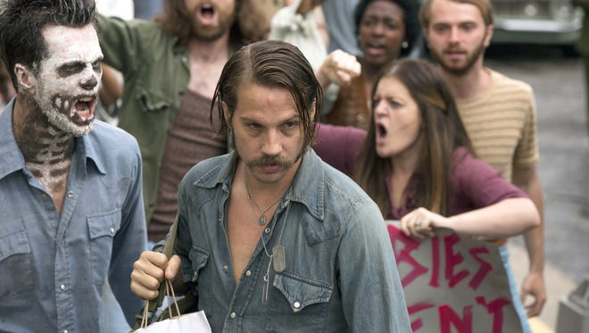 "Returning to Memphis from Vietnam, ex-Marine sniper Mac Conway (Logan Marshall-Green) is heckled by war protesters in episode 1 of  ""Quarry."""