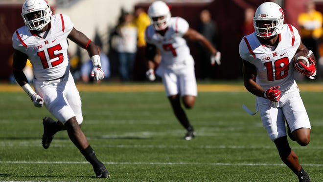 Rutgers cornerback Damon Hayes on his way to the end zone against Minnesota