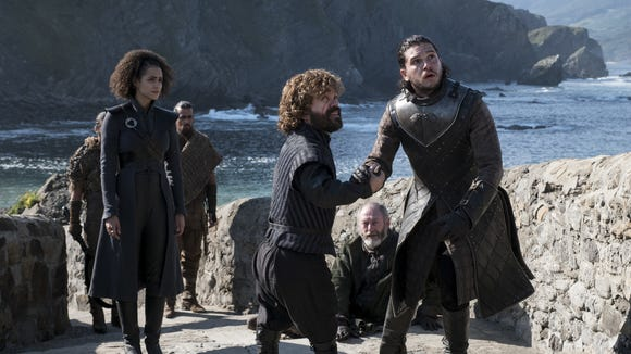 Missendei, Tyrion, Jon and Davos see a dragon fly by