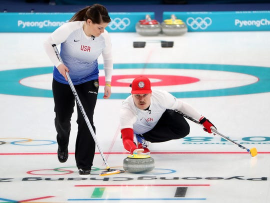 Becca Hamilton and Matt Hamilton compete in the curling