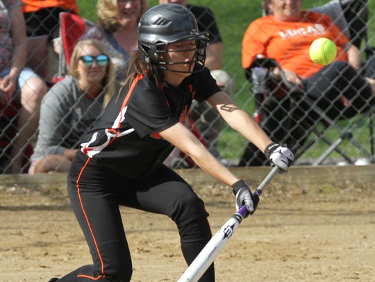 Lucas' Brooke Nowander bunts the ball during a home game against Norwalk St. Paul on Thursday.
