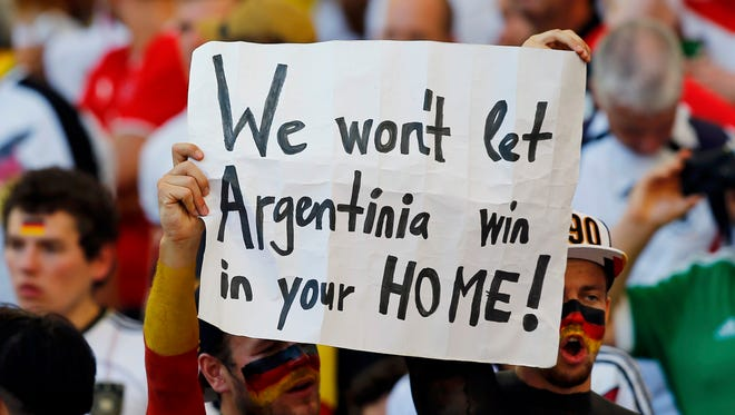 A fan of Germany holds up a placard as he waits for the start of their 2014 World Cup final against Argentina at the Maracana stadium in Rio de Janeiro July 13, 2014.