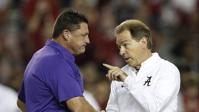 LSU coach Ed Orgeron (left) and Alabama coach Nick Saban meet before the 2017 LSU-Alabama game in Tuscaloosa, Alabama. Saban is scheduled to bring his team to Tiger Stadium on Nov. 14 for a 5 p.m. CBS kickoff after his first loss to LSU last year since the 2011 season.