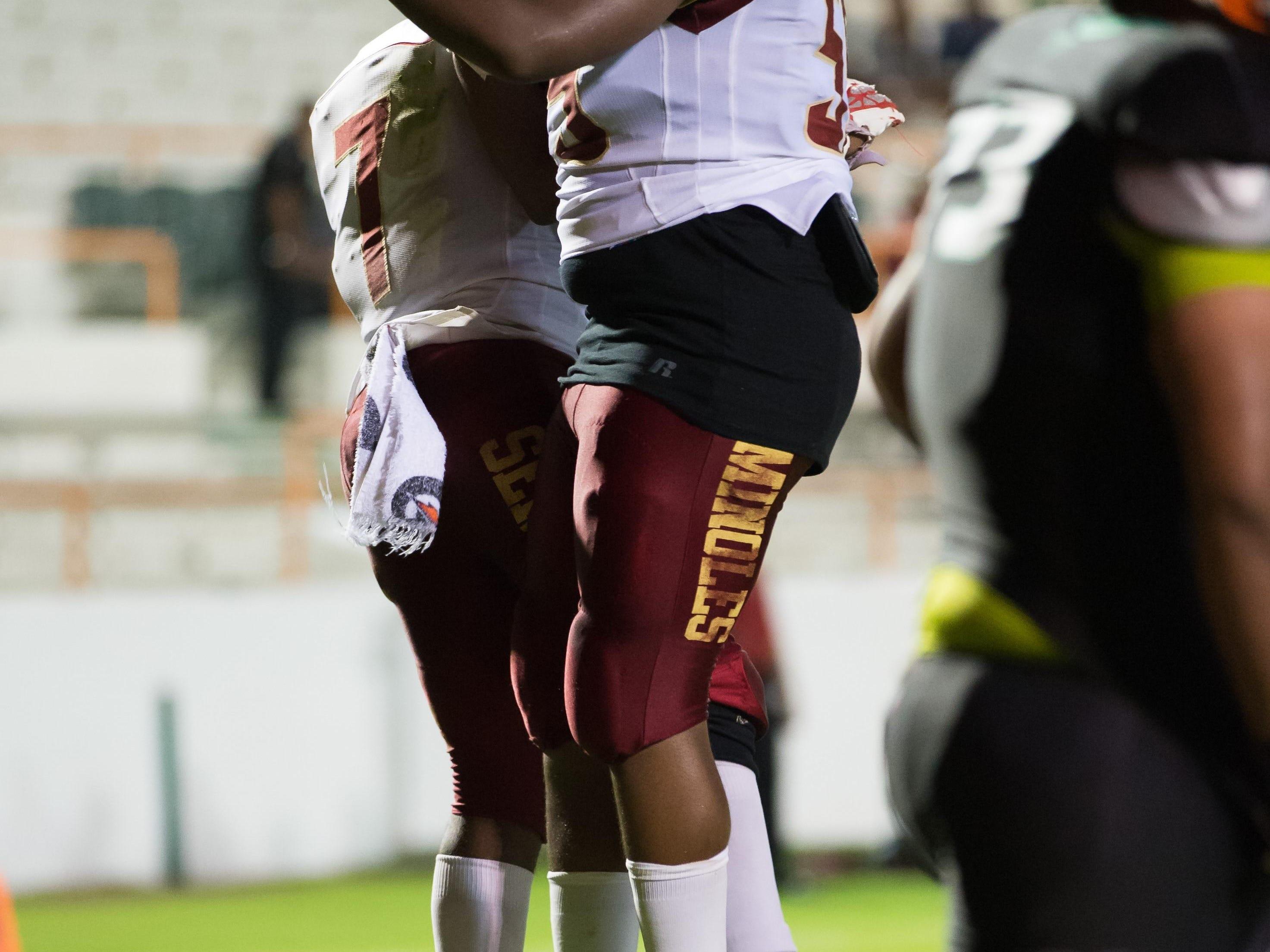 Florida High's Trevor Lucas celebrates a touchdown run in a 42-0 win over Florida High.