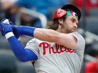 Phils hit 3 HRs, outlast Mets 10-7 to tighten wild-card race