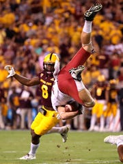 Washington State Cougars wide receiver River Cracraft flips over after being upended against Arizona State at Sun Devil Stadium.