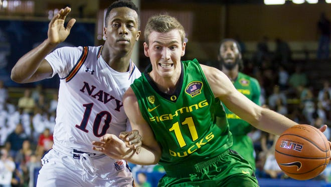 Oregon guard Phil Richmond (11) attempts to get by Navy guard Tilman Dunbar (10) in the first half of an NCAA college basketball game at the Pearl Harbor Invitational on Monday, Dec. 7, 2015, in Honolulu.