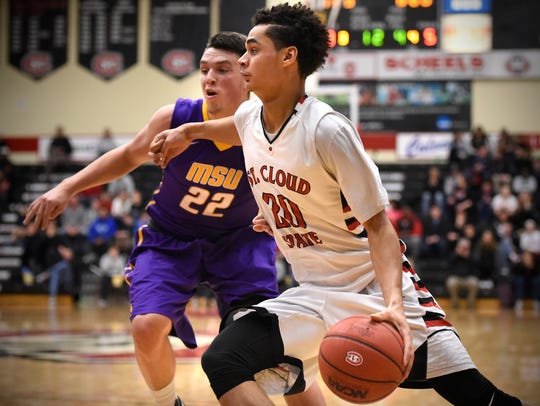 Gage Davis drives to the basket during Saturday's game