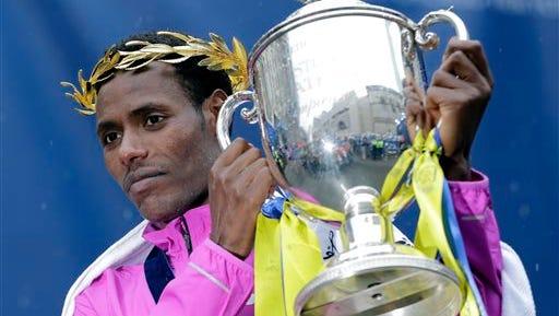 Lelisa Desisa, of Ethiopia, lifts his trophy after winning the Boston Marathon on Monday.
