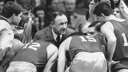 """FILE - In this Dec, 6, 1985, file photo actor Gene Hackman gives fictional Hickory High basketball players instructions during filming of the final game of the movie """"Hoosiers"""" at Hinkle Fieldhouse on the Butler University campus in Indianapolis. Thirty years after the movie came out and six decades after Milan shocked the world with a 32-30 come-from-behind win over Muncie Central, the legacy of that team and those players has lasted longer than anyone could have imagined in 1954."""