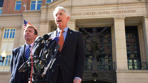 """Virginia Attorney General Mark Herring, right, accompanied by Virginia Solicitor General Stuart Raphael, speaks outside the federal courthouse in Alexandria, Va., Friday, Feb. 10, 2017, following a hearing on President Donald Trump's travel ban. Lawyers for the state of Virginia are challenging President Donald Trump's executive order on immigration, arguing in federal court that his seven-nation travel ban violates the Constitution and is the result of """"animus toward Muslims."""""""