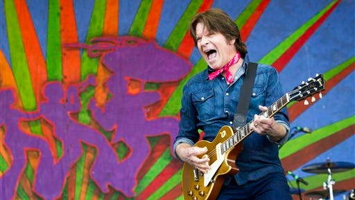 John Fogerty performs on the Samsung Galaxy Stage, Sunday, May 4, 2014, at the New Orleans Jazz and Heritage Festival at the Fair Grounds. (AP Photo/The Advocate, Scott Threlkeld) MANDATORY CREDIT, ONLINE OUT, MAGS OUT, INTERNET OUT, TV OUT, NO SALES, NO FORNS. LOUISIANA BUSINESS INC. OUT (INCLUDING GREATER BATON ROUGE BUSINESS REPORT, 225, 10/12, INREGISTER, LBI CUSTOM