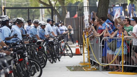Demonstrators yell to police from behind a barricade