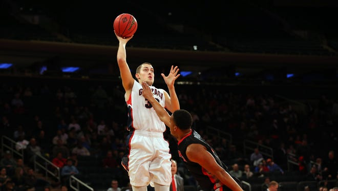 Gonzaga forward Kyle Wiltjer shoots over Georgia guard Juwan Parker during the first half at Madison Square Garden.