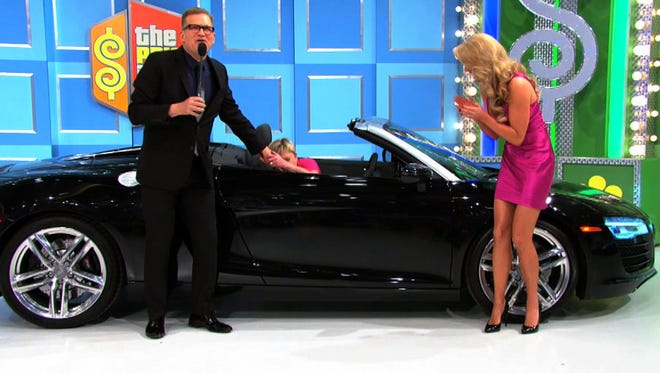 'The Price is Right' host Drew Carey offers a reassuring hand to the Tacoma, Wash., woman who just won an Audi R8 on the show