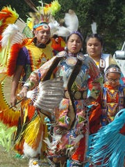 Coushatta Indians perform a traditional dance at Saturday's