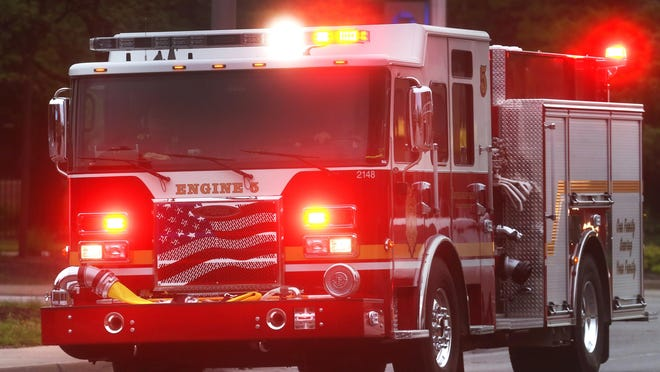 An Indianapolis Fire Department firetruck makes a medical run to the scene of an attempted robbery of a CVS at 16th and Meridian streets on Monday, May 18, 2015.