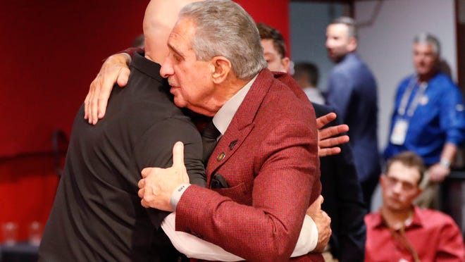 Atlanta Falcons owner Arthur Blank, right, embraces Atlanta Falcons head coach Dan Quinn after an NFL football game against the Seattle Seahawks, Sunday, Oct. 27, 2019, in Atlanta. The Seattle Seahawks won 27-20. (AP Photo/John Bazemore)