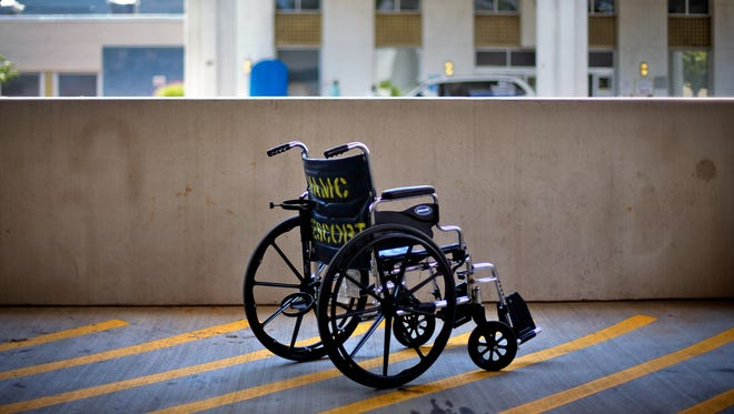 A wheelchair sits outside the VA Medical Center in Atlanta. The department's chief medical examiner retired Wednesday, the latest official to leave the VA following disclosure of problems in medical care for veterans at facilities around the country.