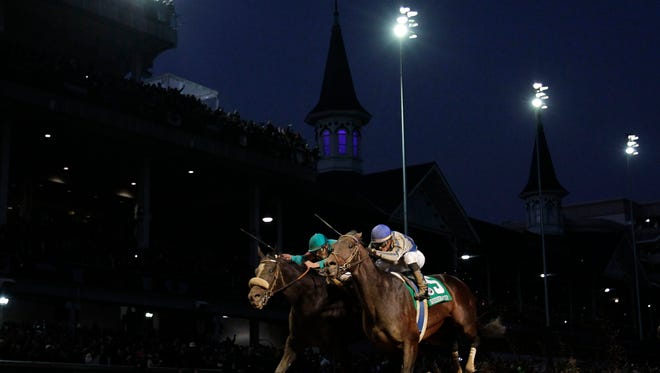 Garrett Gomez, right, rides Blame to victory during the 2010 Breeders' Cup Classic at Churchill Downs.