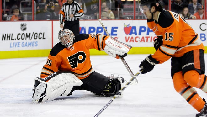 Steve Mason made five saves before leaving the game with an apparent right knee injury.