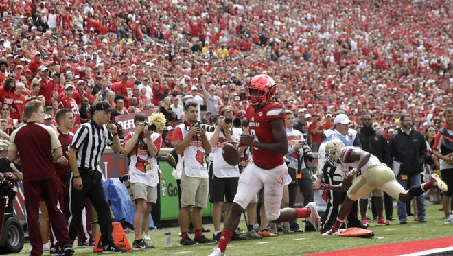 Louisville's Lamar Jackson runs out of bounds at the 1-yard line just before scoring during their game against FSU at Papa John's Cardinal Stadium in Louisville on Saturday.