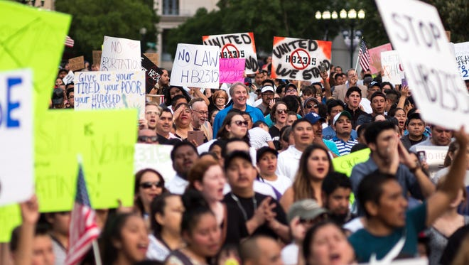 Hundreds of demonstrators  gather during a protest against HB 2315, a bill that would ban sanctuary cities in Tennessee and require local law enforcement detain certain immigrants, at Legislative Plaza in Nashville, Tenn., Wednesday, May 16, 2018.