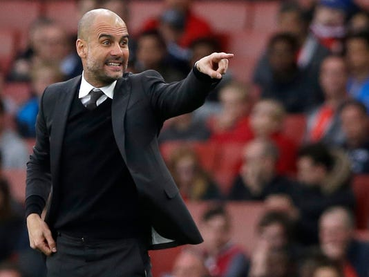 FILE - This is a Sunday, April 2, 2017 file photo of Manchester City manager Pep Guardiola as he gestures during the English Premier League soccer match between Arsenal and Manchester City at the Emirates stadium in London. It's been another off season of comings and goings as Manchester City manager Pep Guardiola attempts to deepen his imprint at the Etihad Stadium by spending around $300 million. (AP Photo/Alastair Grant, File)