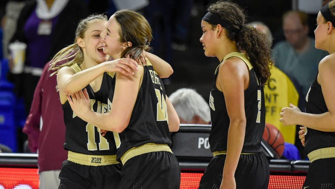 Upperman High School Chloe Maynord (11) and Torie Brooks (20) celebrate after defeating East Nashville High School in the TSSAA Basketball Girls State Championship at the Murphy Center in Murfreesboro, Tenn., Thursday, March 8, 2018.