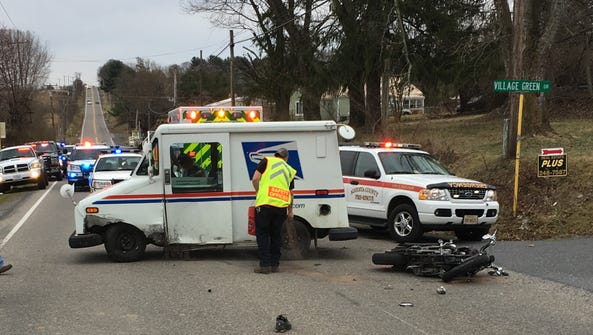 A motorcycle and postal truck collided head-on just