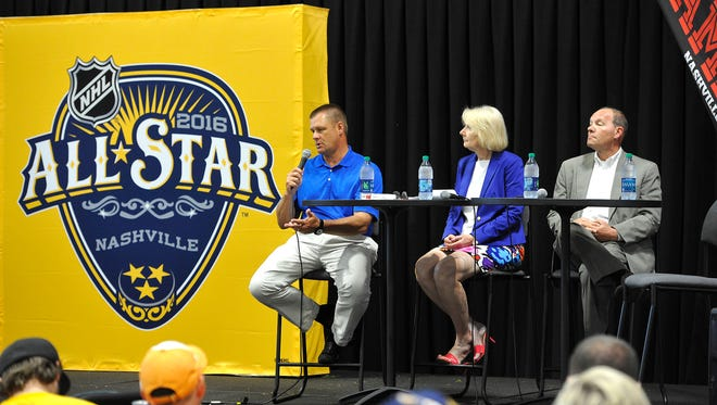 Sports Council's Scott Ramsey, Bridgestone's Christine Karbowiak, and Predators CEO Jeff Cogen unveil the Predators 2016 NHL All-Star logo at the Music City Sports Festival Saturday.