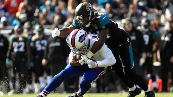 JACKSONVILLE, FL - JANUARY 07: Outside linebacker Myles Jack #44 of the Jacksonville Jaguars tackles quarterback Tyrod Taylor #5 of the Buffalo Bills in the second quarter during the AFC Wild Card Playoff game at EverBank Field on January 7, 2018 in Jacksonville, Florida.  (Photo by Mike Ehrmann/Getty Images)