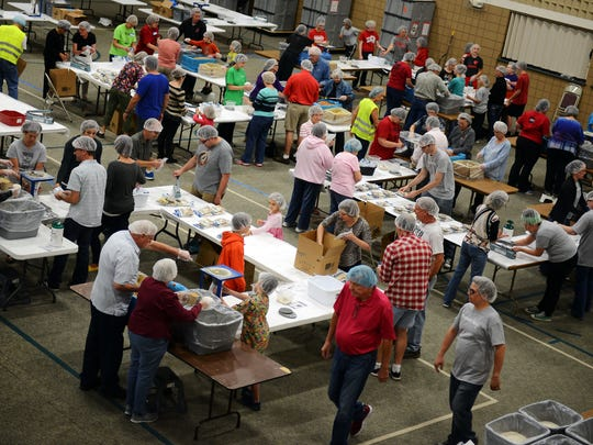 In the first shift, about 180 volunteers helped pack, box, label and stock rice, soy and dried vegetable packets at the Feed My Starving Children MobilePack event Tuesday at Green Bay Community Church in Howard.