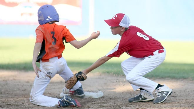 Rt. B Cafe's Alex Ewings steals second on a close play while CARSTAR shortstop Charles Alexander applies the tag in the second inning Wednesday night in Cal Ripken Major at the Cooper County Baseball Association ballfield at Harley park. Rt. B Cafe defeated CARTSTAR 9-6.