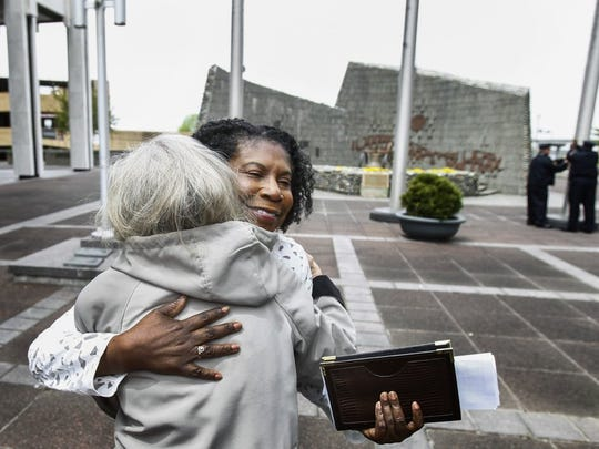 April 13, 2016 - Dr. Katherine Lawson (right) receives a hug from Pat Murrell (left) after giving closing remakes during the Memphis Child Advocacy Center Children's Memorial Flag Raising event at Civic Center Plaza Wednesday afternoon. Lawson, is the executive director of Victims to Victory advocacy group that supports families of homicide victims. (Mark Weber/The Commercial Appeal)