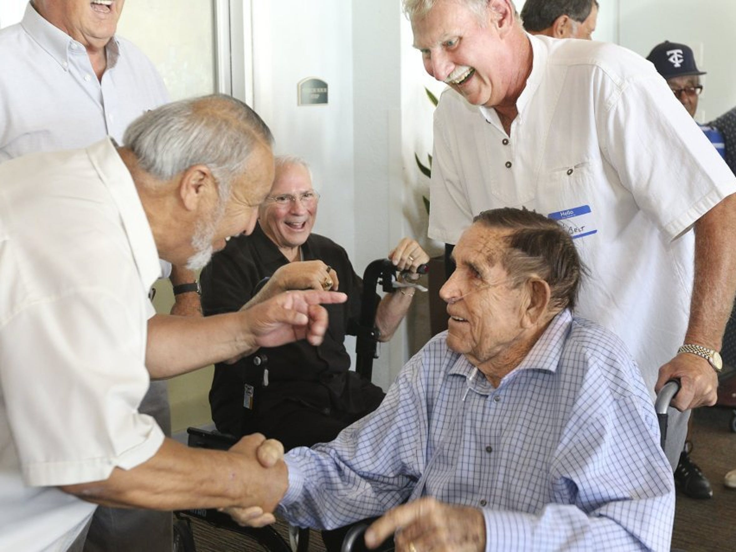 Hector Salinas (left) greets his former coach at Carroll Dave Donnan (center) with Phil Belt at right and John Saenz at the Carroll Hall of Fame ceremony in 2017. Salinas was a pitcher for the Tigers in 1962, the first time they qualified for the state baseball tournament.