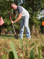 Steven Scofield, of Wilmington, helps to clean up the