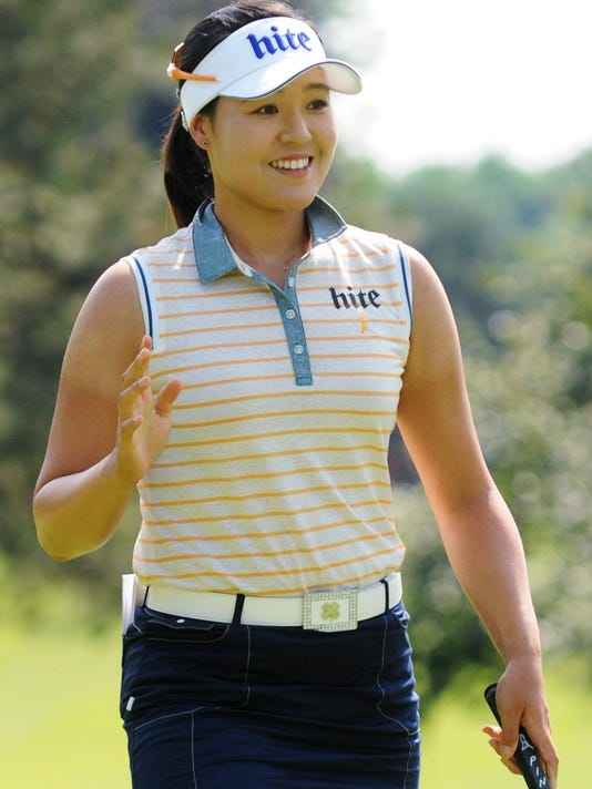 In Gee Chun waves Saturday, June 18, 2016, during the third round of the Meijer LPGA Classic golf tournament in Belmont, Mich. (Cory Olsen/The Grand Rapids Press via AP)